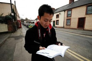 reading guidebook in street