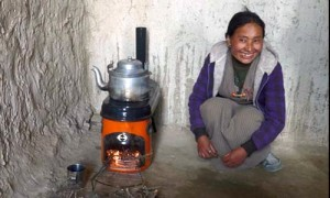 Nepalese woman with Stove