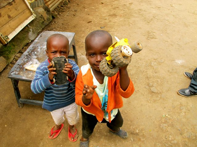 Kids in Kibera With Toy Cars