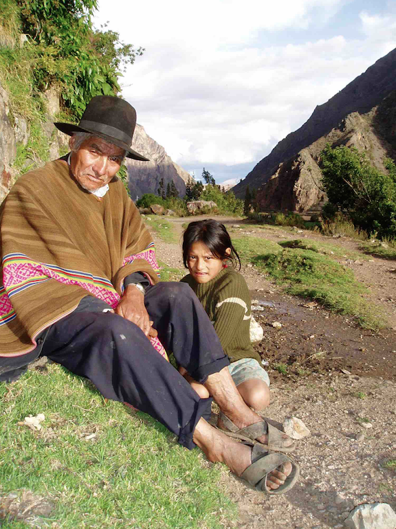 Grandfather and granddaughter rest alongside Peru's Inca Trail